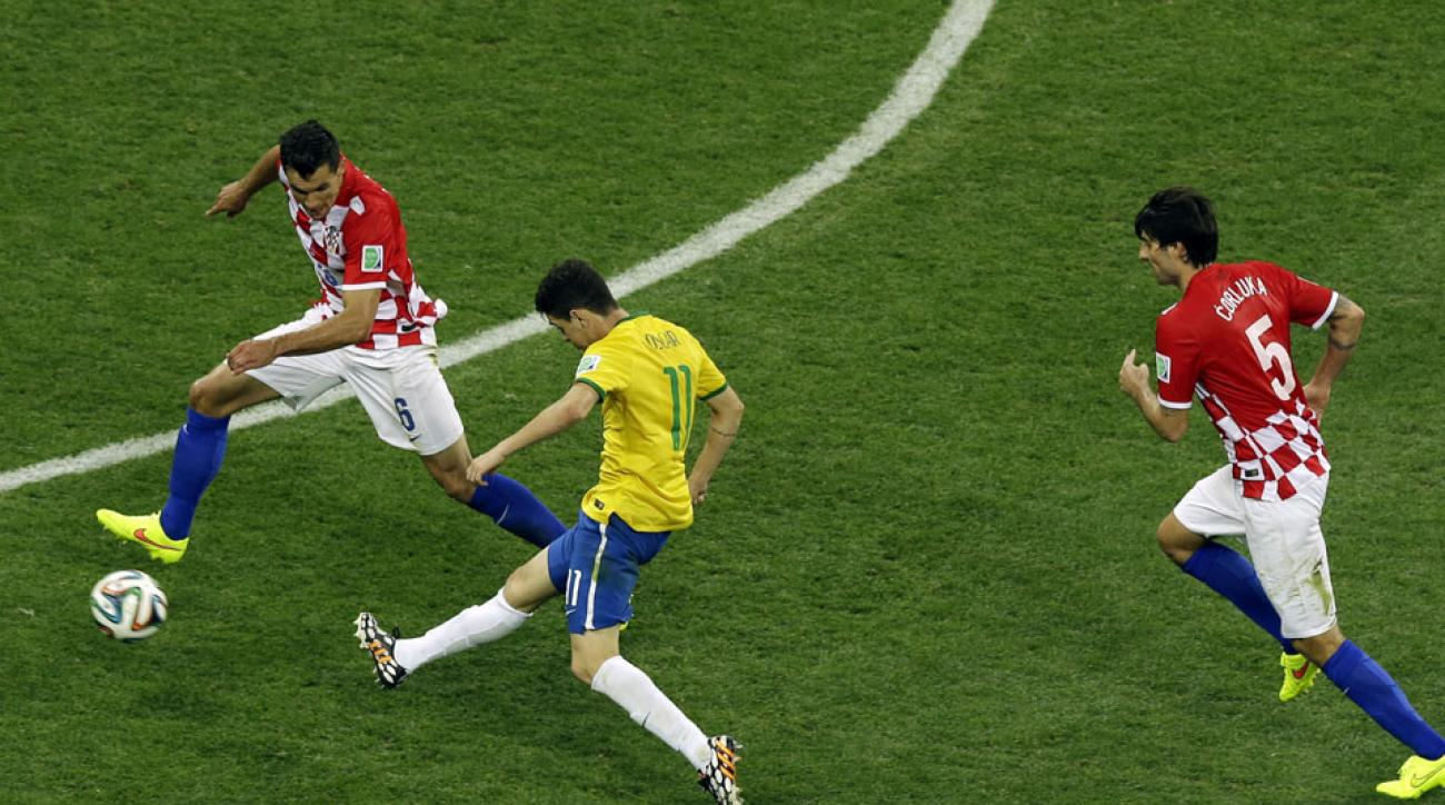Brazil's Oscar scores his team's third and final goal in the World Cup opening match against Croatia.