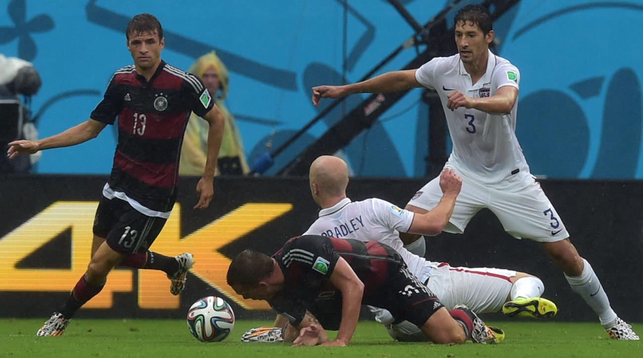USA's Omar Gonzalez, right, and Michael Bradley had their hands full trying to combat Germany's Thomas Muller, left, and Lukas Podolski.