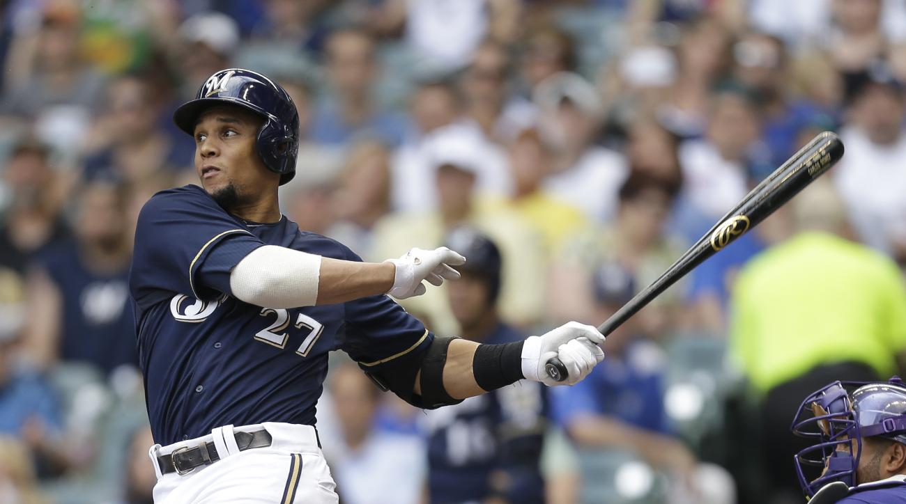 Carlos Gomez suffered a head injury on Friday when he collided with Rockies second baseman Josh Rutledge's leg.