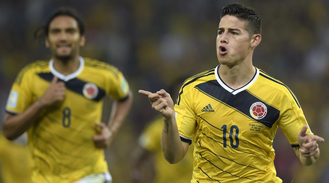James Rodriguez, right, celebrates after his tremendous volley put Colombia ahead of Uruguay in the round of 16.