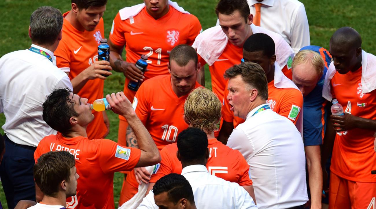 Netherlands manager Louis van Gaal, right giving instructions during a cooling break, is one of a handful of managers to turn to a three-center back system at the World Cup.