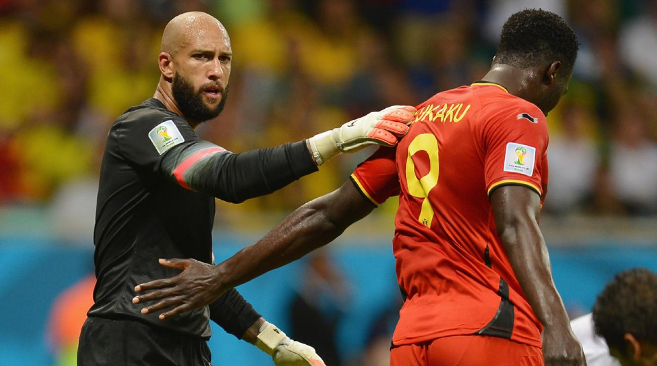 U.S. goalkeeper Tim Howard shares an embrace with club teammate and World Cup foe Romelu Lukaku, who scored the eventual game-winning goal in Belgium's 2-1 win over the USA.