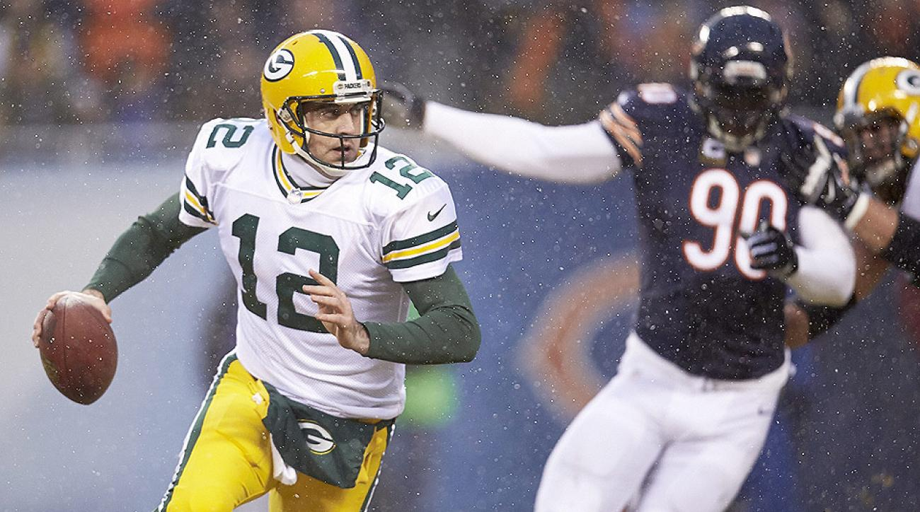 Julius Peppers (right) will be terrorizing other NFC North QBs this year after he joined the Packers this offseason.