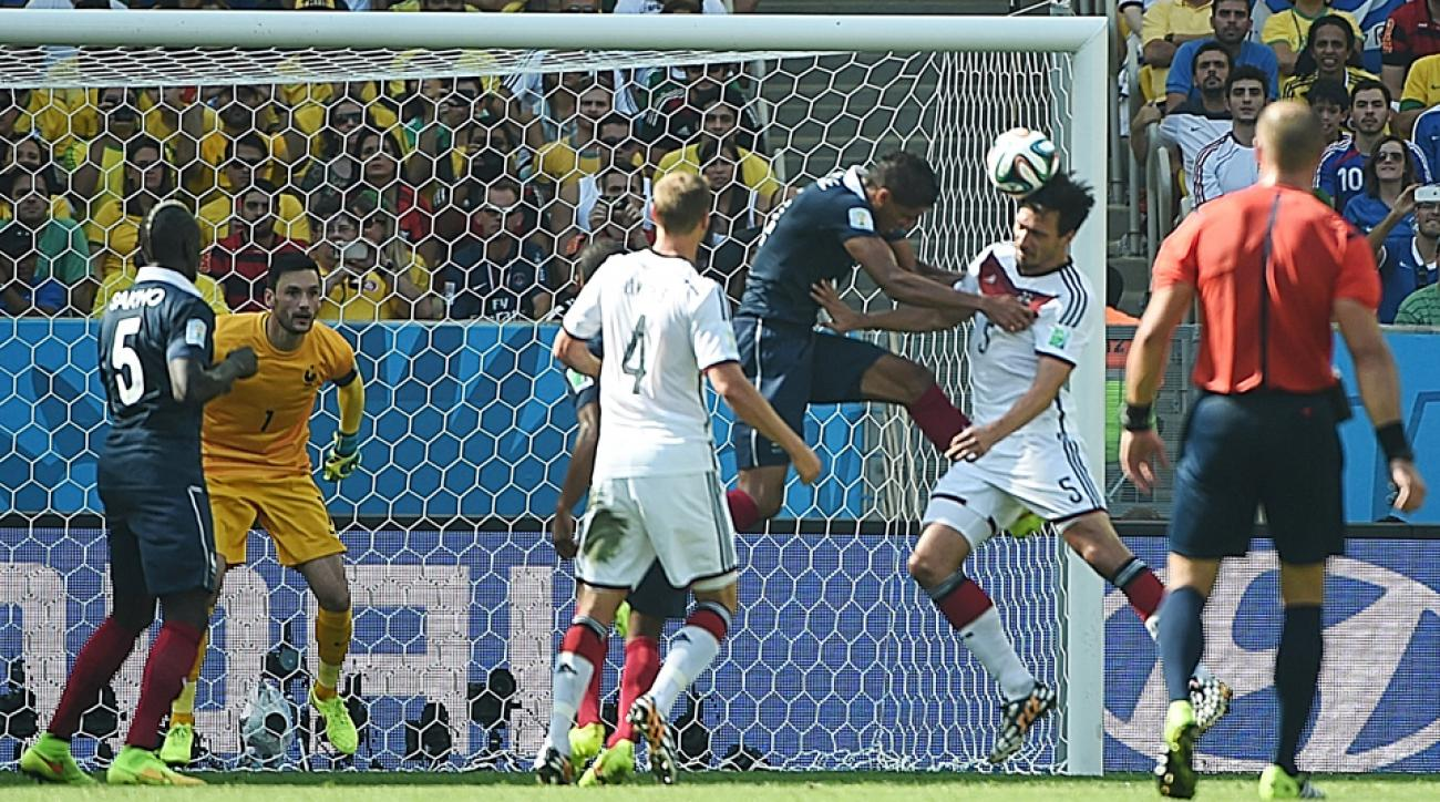 Germany's Mats Hummels (5) heads the first-half goal by France goalkeeper Hugo Lloris to put his side into the World Cup semifinals for a fourth straight time.