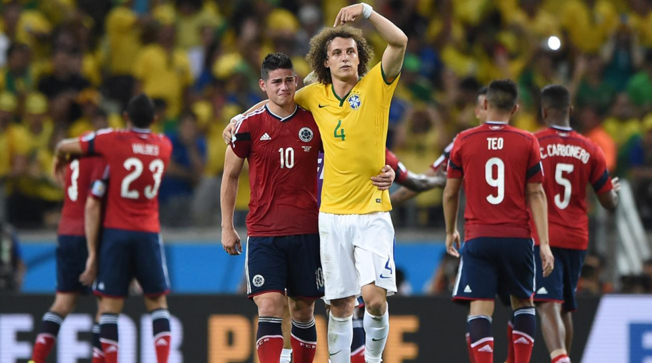 Brazil's David Luiz points to Colombia's James Rodriguez and asks for a crowd ovation after Brazil's 2-1 win over Colombia in Fortaleza on Friday.