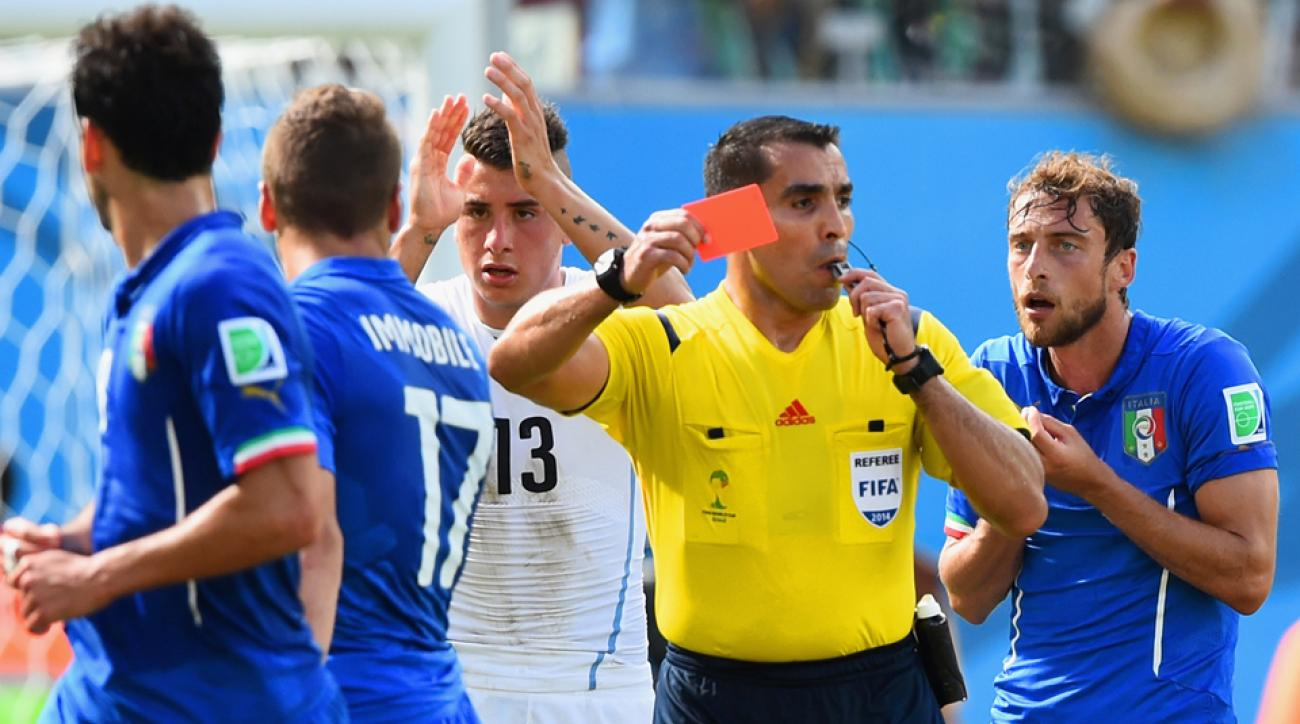 Mexican referee Marco Antonio Rodriguez, shown above giving a red card to Italy's Claudio Marchisio in the group stage, will referee Tuesday's semifinal between Brazil and Germany.