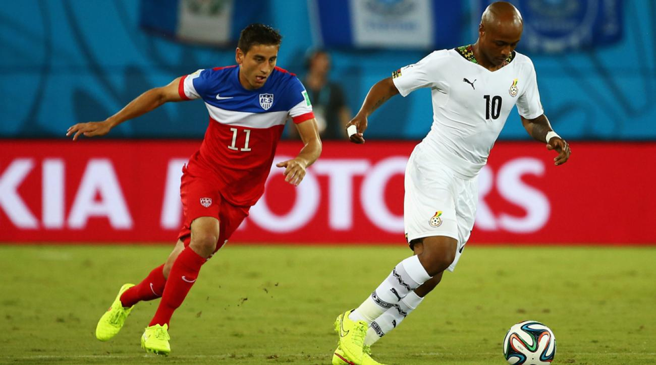 USA midfielder Alejandro Bedoya, left, tracks Ghana's Andre Ayew during the opening game of the World Cup.