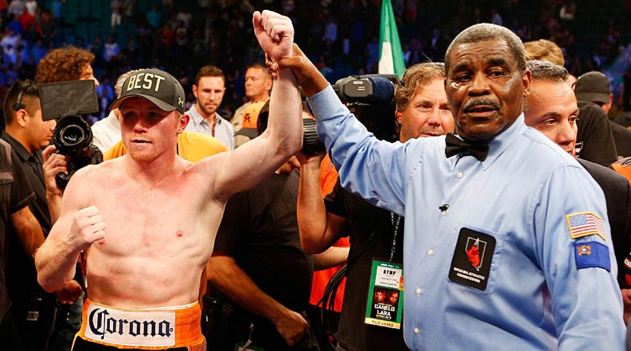 "Saul ""Canelo"" Alvarez poses after his split-decision victory over Erislandy Lara during their junior middleweight bout in Las Vegas."