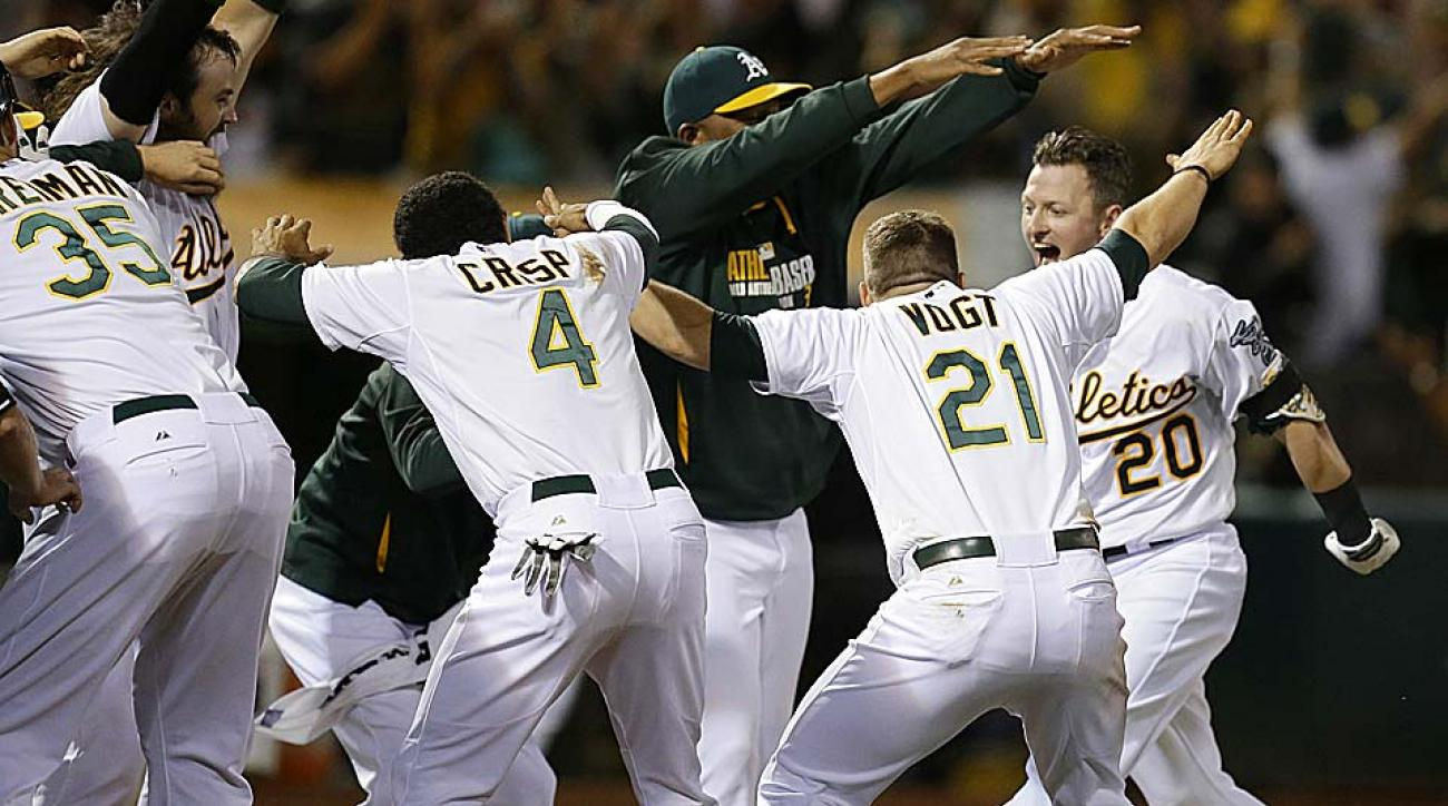 Oakland's Josh Donaldson (20) celebrates his walk-off HR which lifted the Athletics to a 5-4 win over the Baltimore Orioles Friday night.