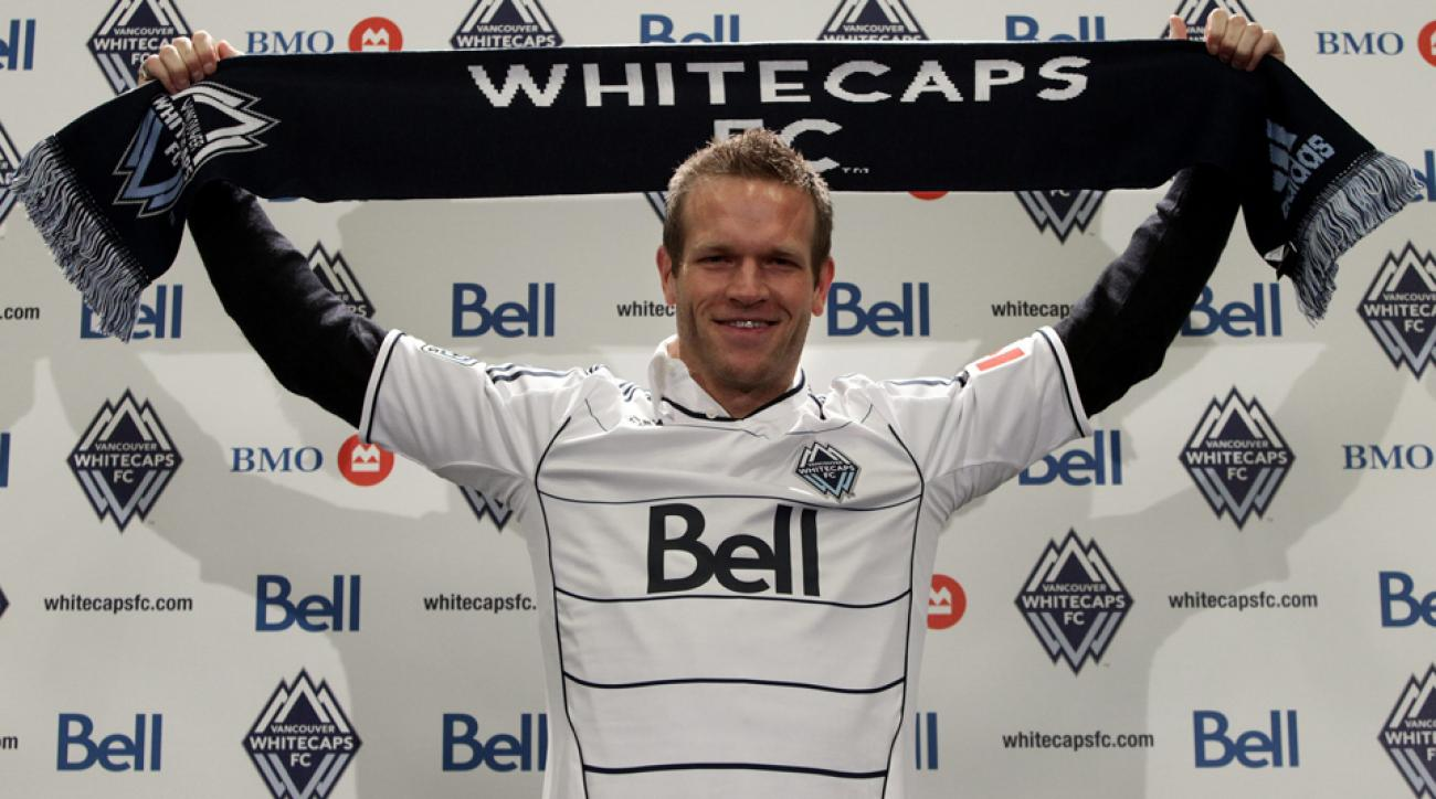 Jay DeMerit, who announced his retirement Thursday, is pictured above on the day he became the Vancouver Whitecaps' first player signing.