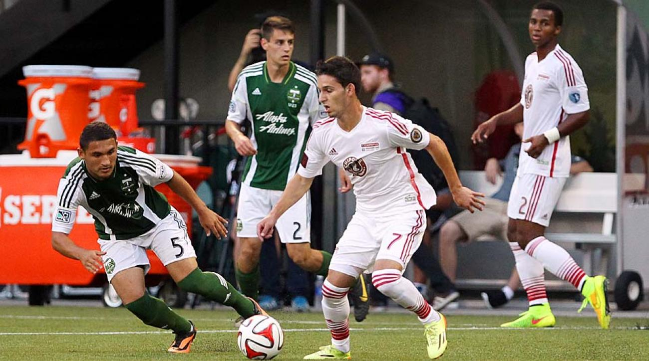 MLS Homegrown player Zach Pfeffer (7) tries to fend off Portland U-23 midfielder Christian Roldan.