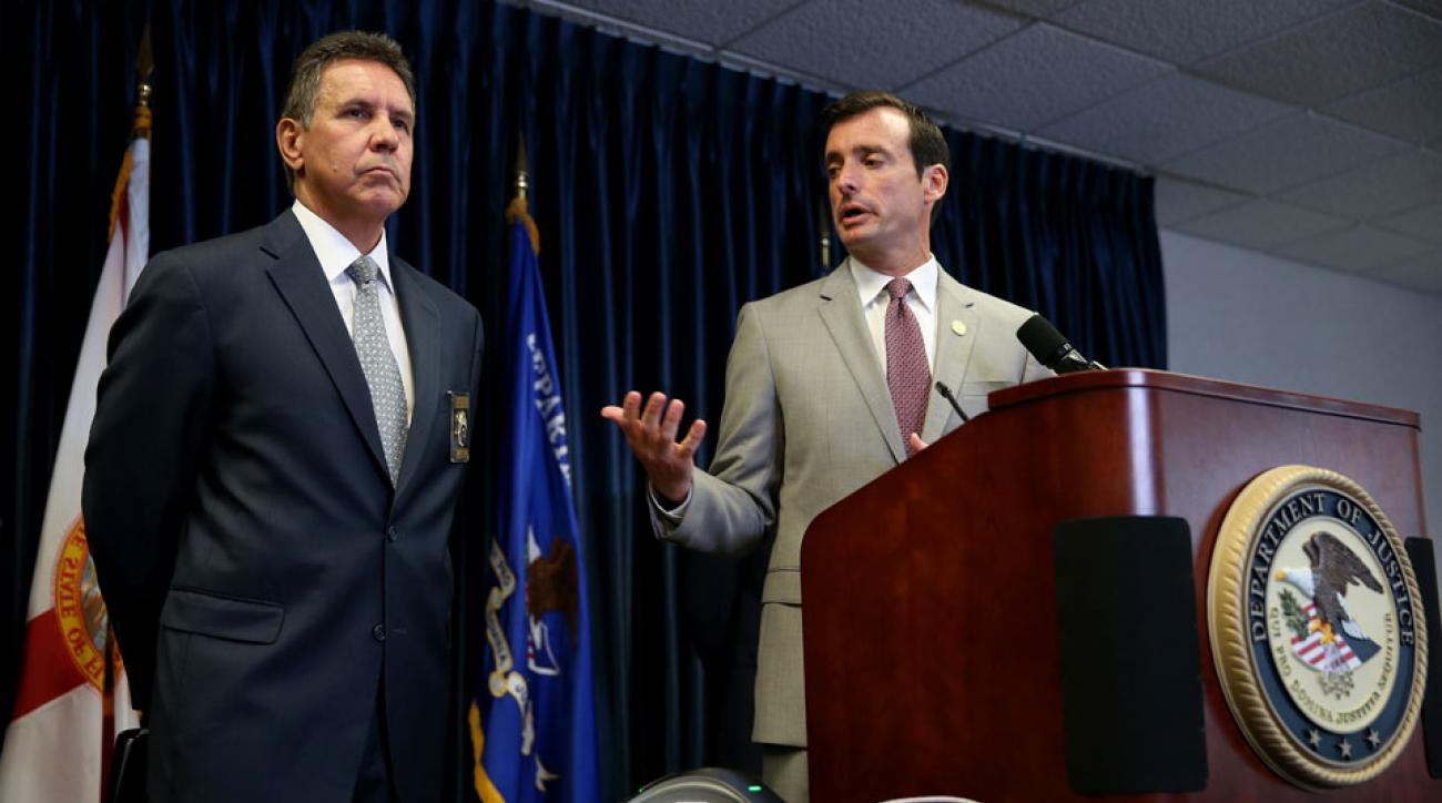 Mark R. Trouville, Special Agent in Charge for DEA Miami, (L) and U.S. Attorney Wifredo A. Ferrer speak to the media about those arrested in connection with the MLB Biogenesis case