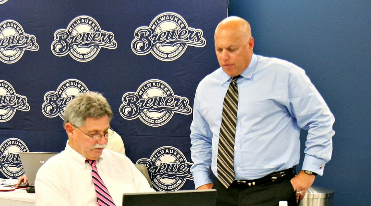 Brewers general manager Doug Melvin and scouting director Bruce Seid (right) at work during the 2009 MLB Draft.