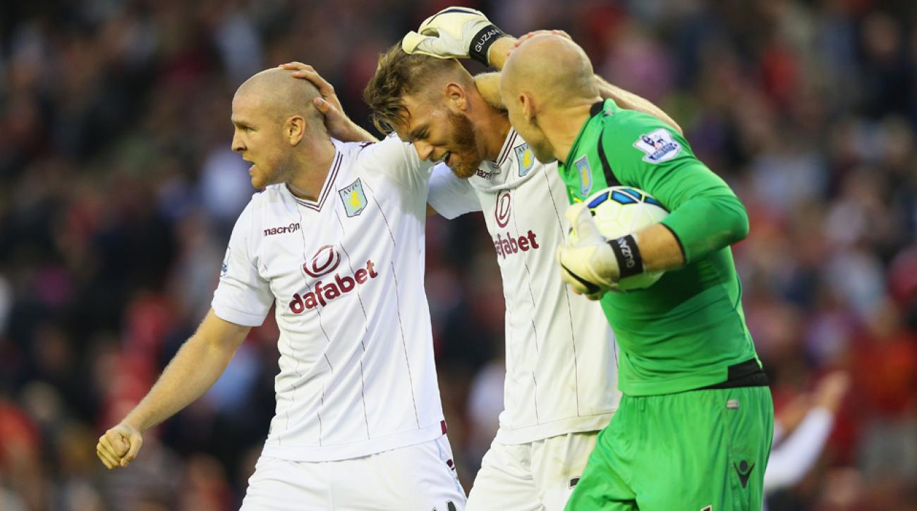 From left, Philippe Senderos, Nathan Baker and American goalkeeper Brad Guzan celebrate Aston Villa's 1-0 win over Liverpool.