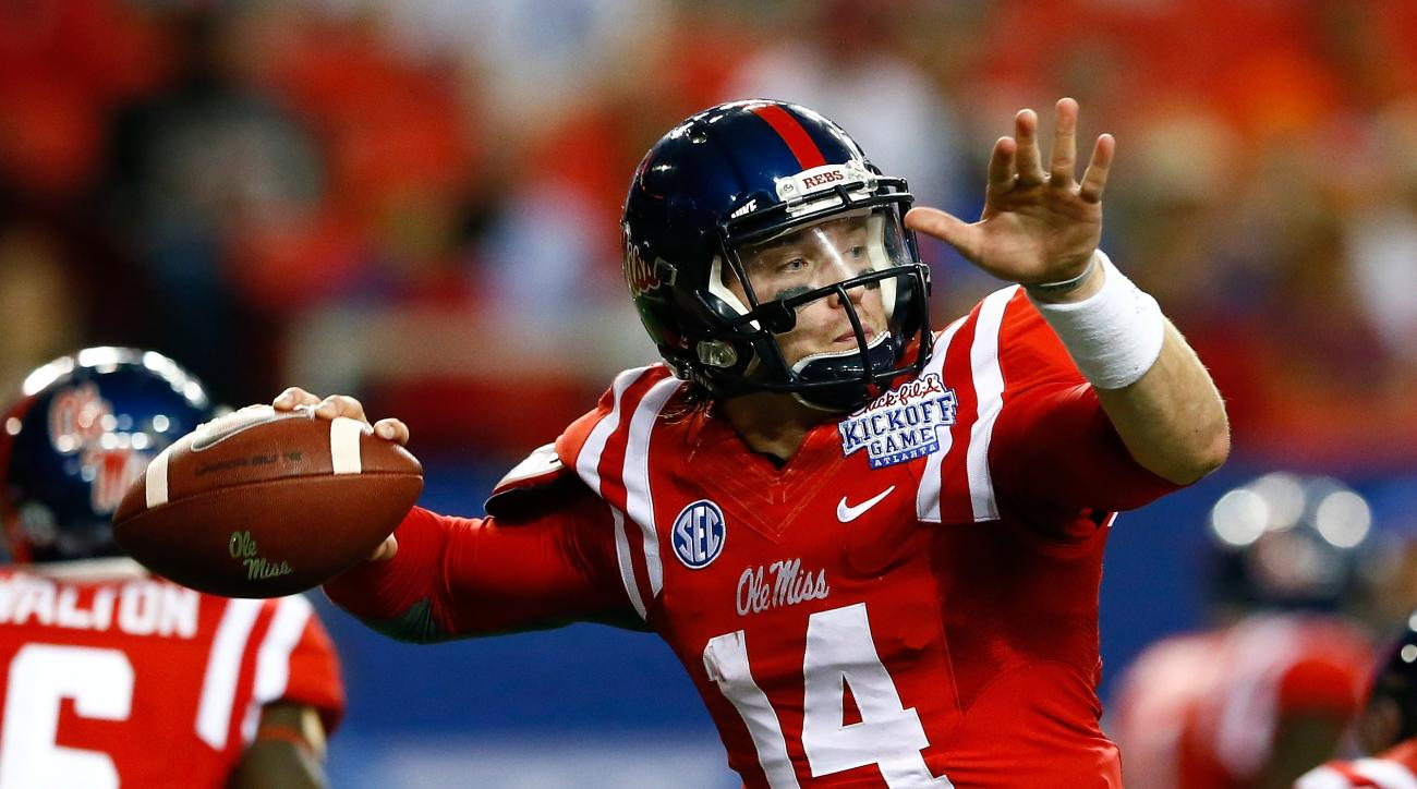 Bo Wallace of the Mississippi Rebels looks to pass against the Boise State Broncos at Georgia Dome on August 28, 2014 in Atlanta, Georgia.
