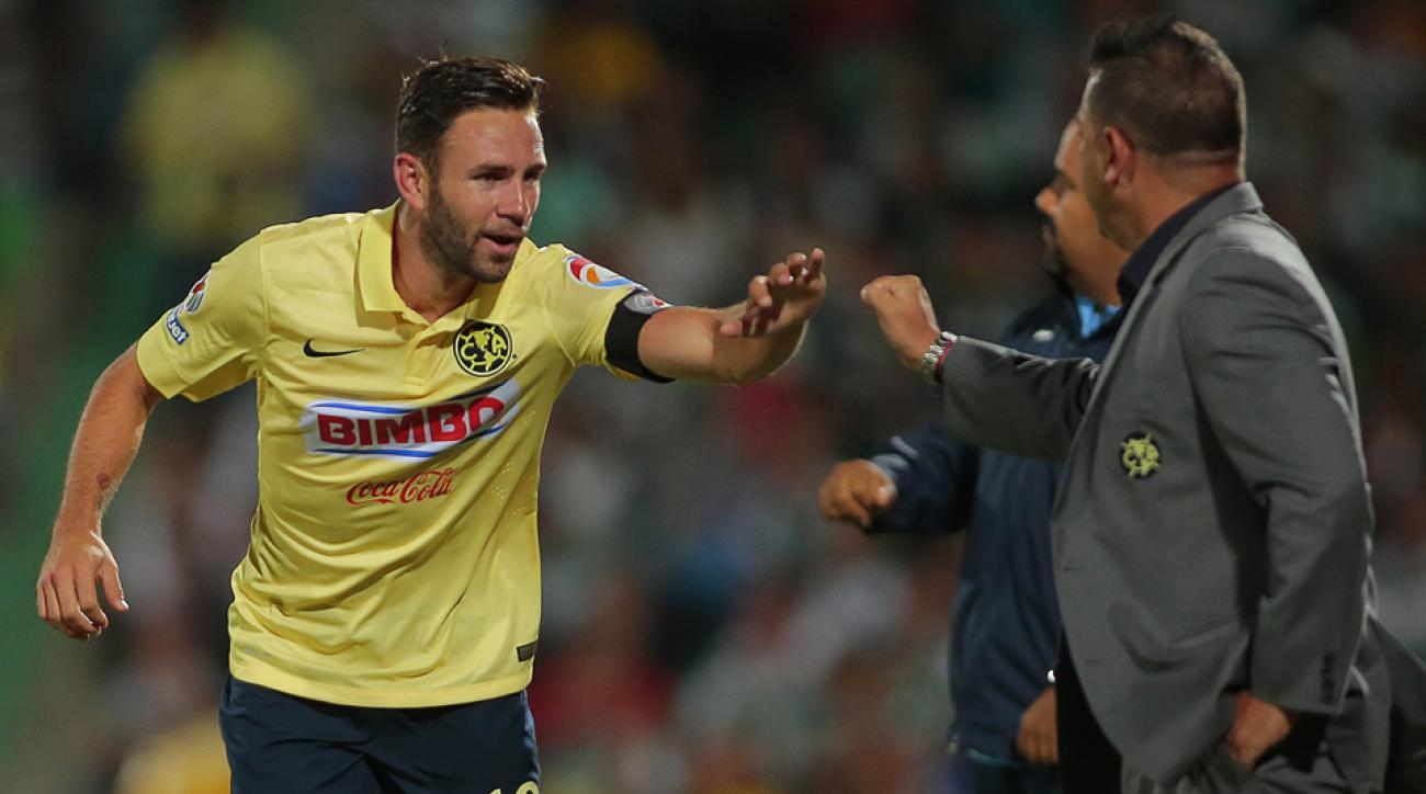 Miguel Layun, left, celebrates one of his four goals in America's 4-1 win over Santos Laguna.