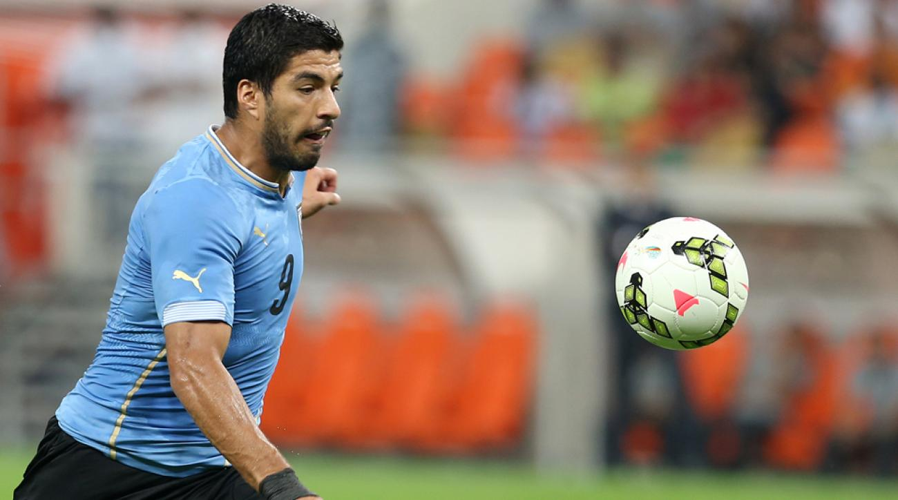 Luis Suarez forced an own goal in his first match with Uruguay's national team since his World Cup bite.