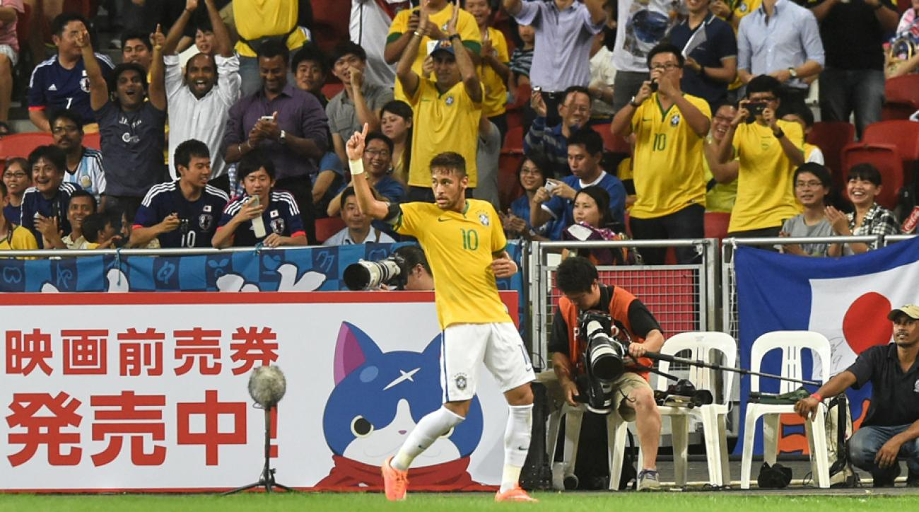 Neymar celebrates after one of his four goals in Brazil's 4-0 win over Japan.