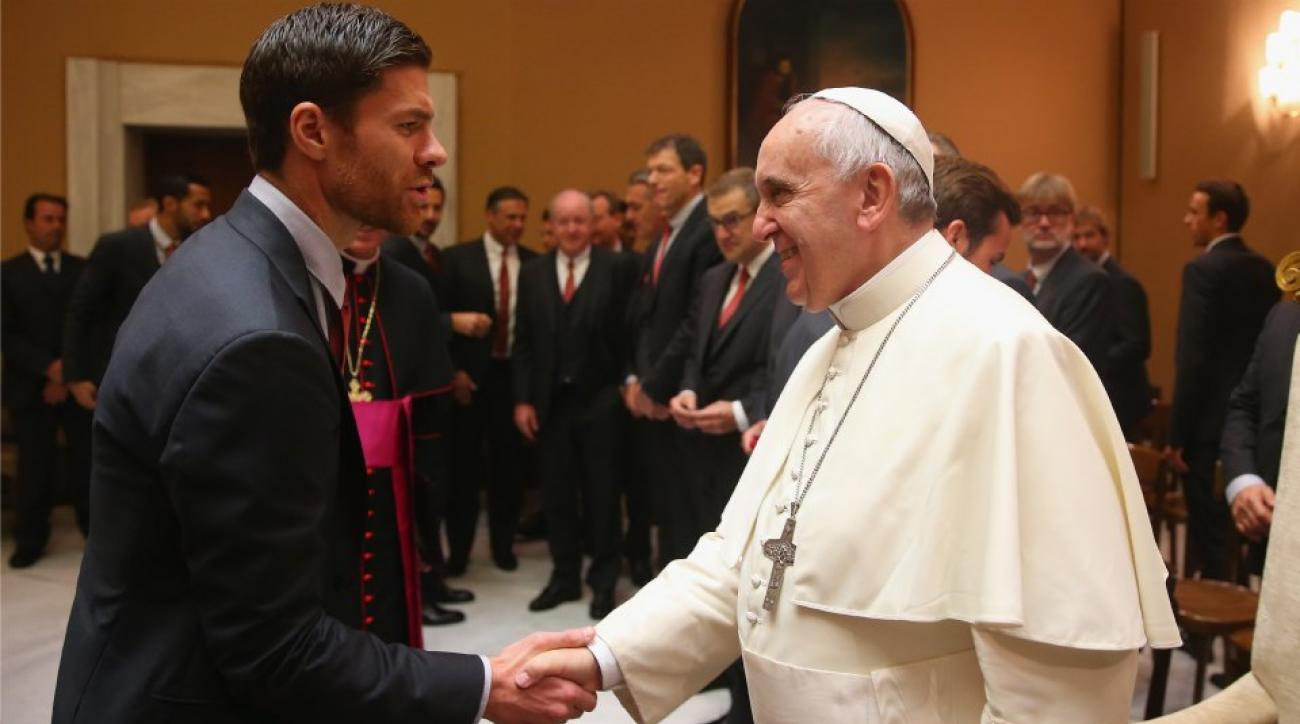Bayern Munich's Xabi Alonso shakes hands with the Pope