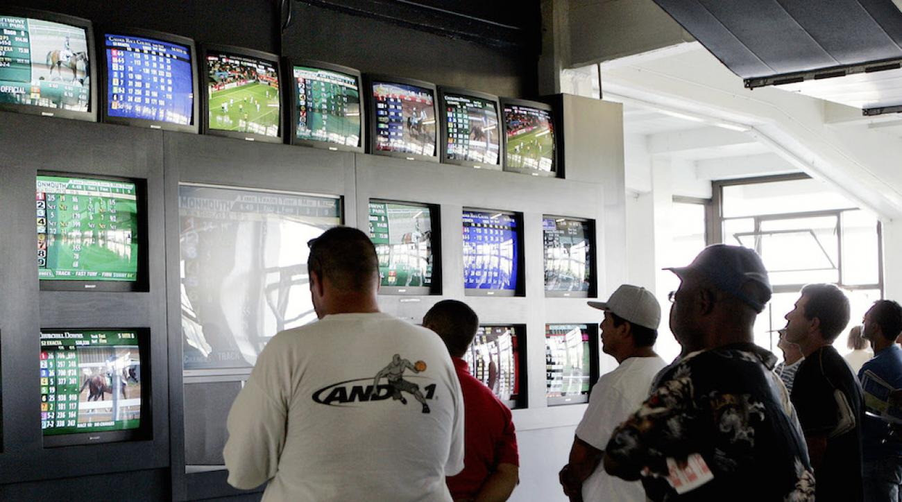 Bettors keep tabs on races at New Jersey's Monmouth Park Casino and Racetrack, which was slated to be the first New Jersey casino to offer legalized sports wagering