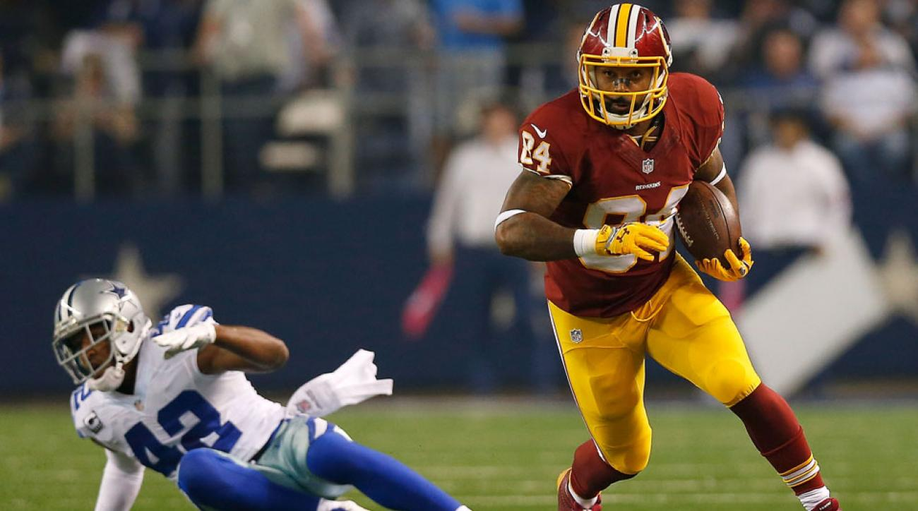 Washington Redskins tight end Niles Paul was able to escape from Cowboys safety Barry Church.