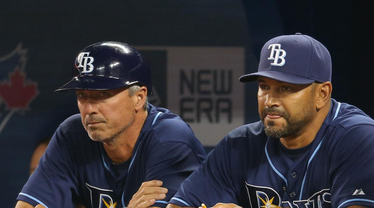 Third base coach Tom Foley and bench coach Dave Martinez