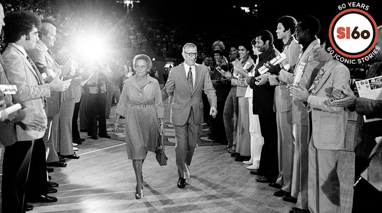 John Wooden with his wife Nell being honored during his retirement in 1975.