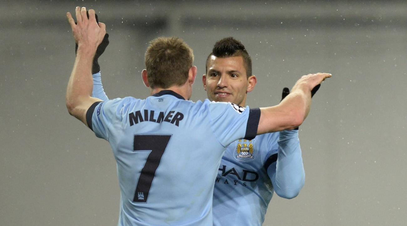 James Milner, left, and Sergio Aguero hope to lead Manchester City to another win over rival Manchester United.
