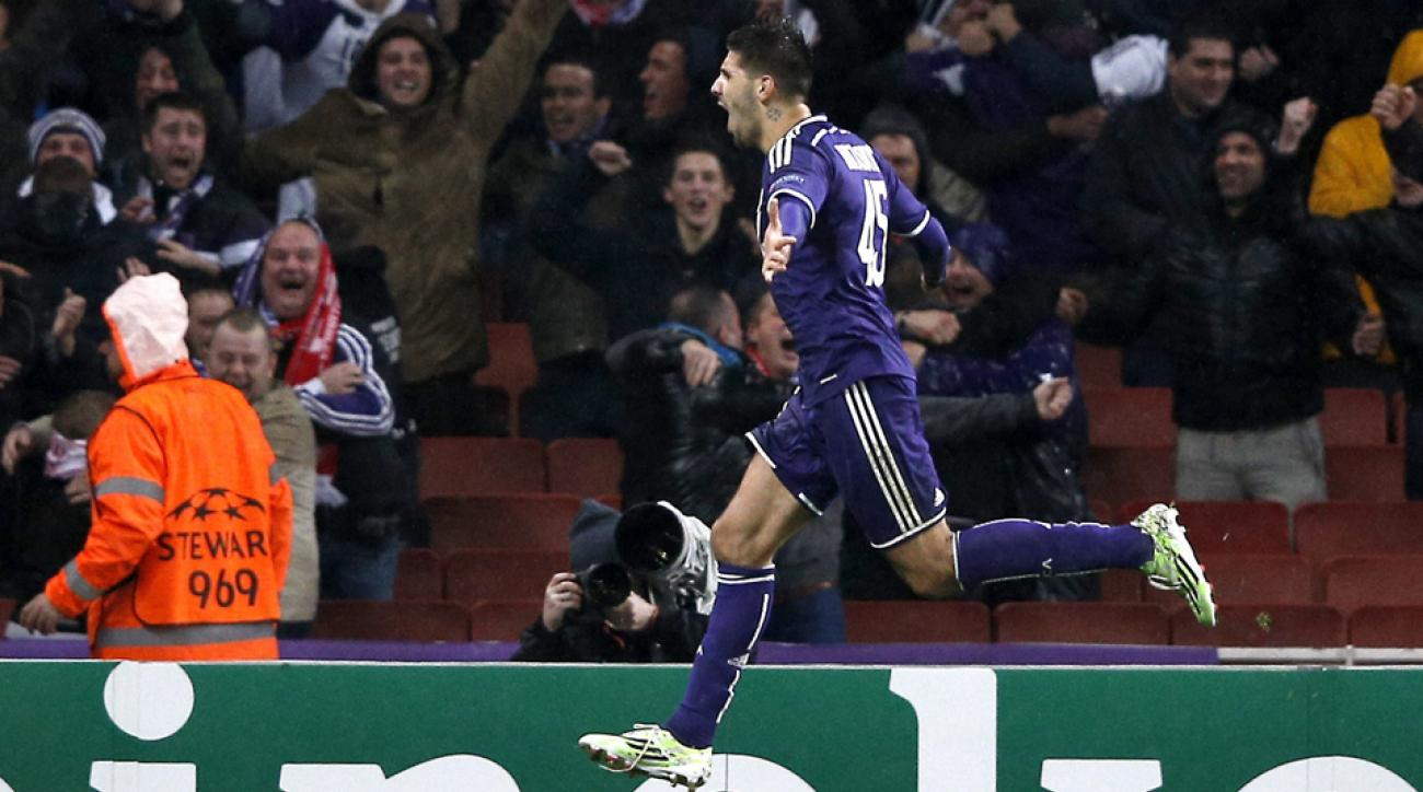 Aleksandar Mitrovic celebrates his stunning late equalizer that lifted Anderlecht to a 3-3 draw at Arsenal in the Champions League.