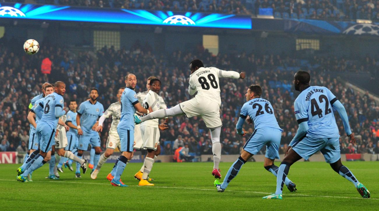 Seydou Doumbia (88) heads home the opening goal for CSKA Moscow against Manchester City.