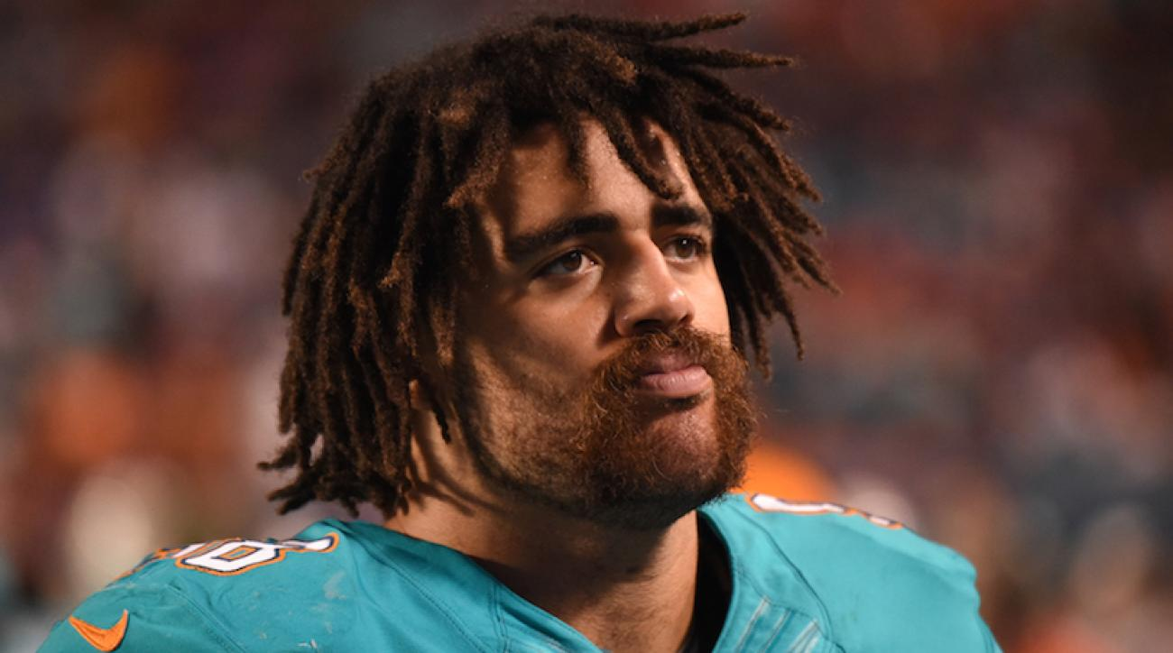 FILE: Jared Odrick #98 of the Miami Dolphins looks on during a NFL game against the Buffalo Bills at Sun Life Stadium on November 13, 2013 in Miami Gardens, Florida.