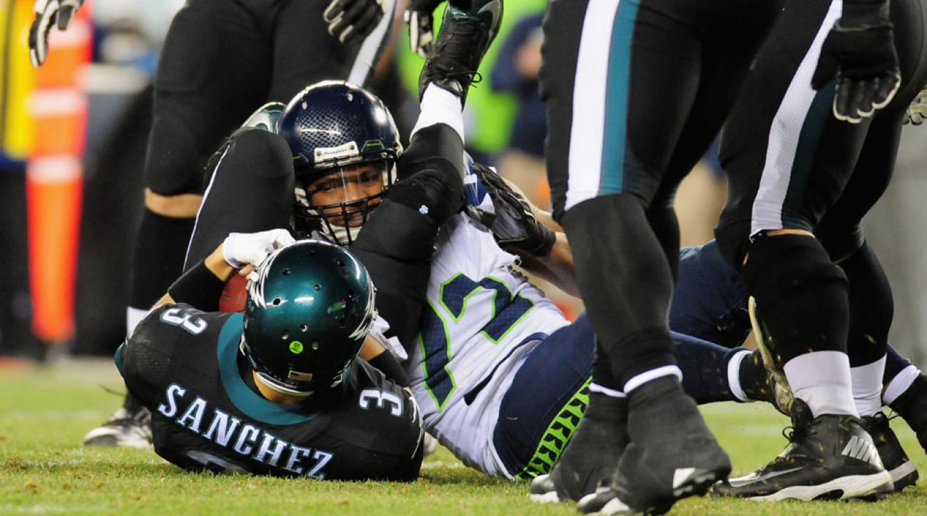 Michael Bennett, #72 of the Seattle Seahawks, Mark Sanchez, #3 of the Philadephia Eagles, getting acquainted.