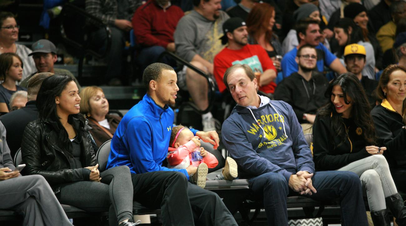 Golden State owner Joe Lacob and Stephen Curry sit court side at a Santa Cruz Warriors-Austin Toros game in November 2013.
