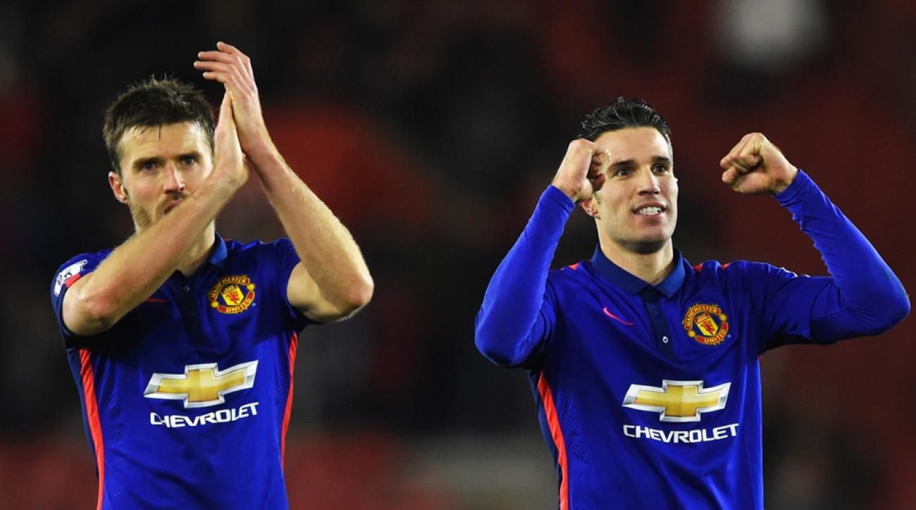 Things are looking up for Michael Carrick, left, Robin van Persie, right, and Manchester United.