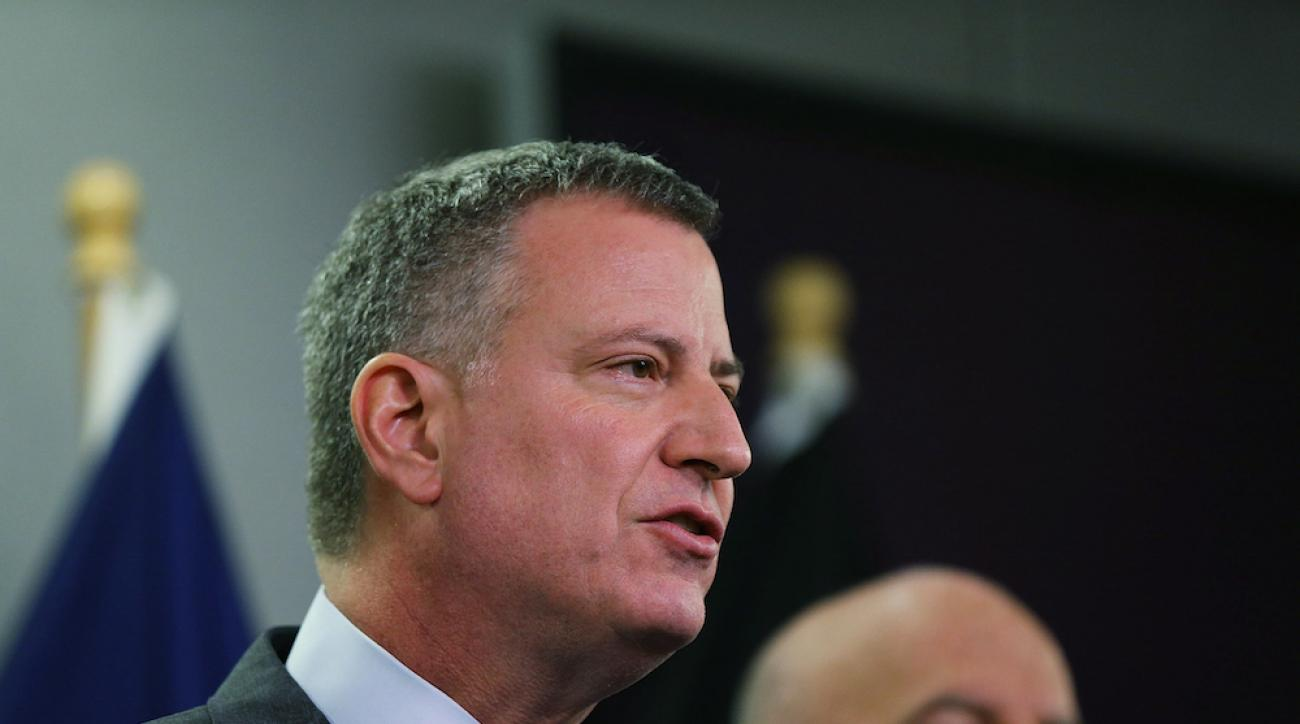 New York City Mayor Bill de Blasio, who was raised in Cambridge, Mass., has said he is rooting for the New England Patriots in Super Bowl XLIX.