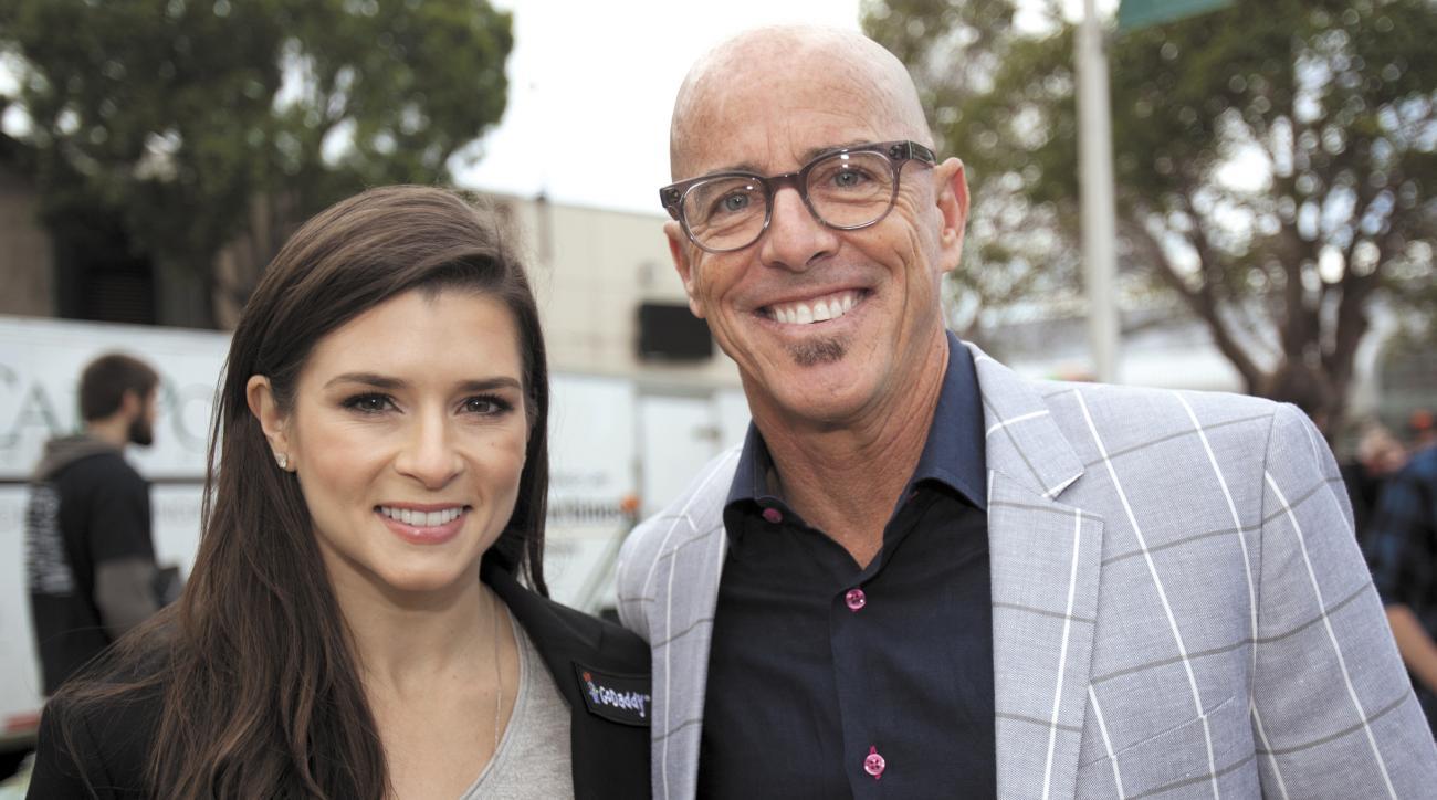 GoDaddy CEO Blake Irving with company spokeswoman Danica Patrick