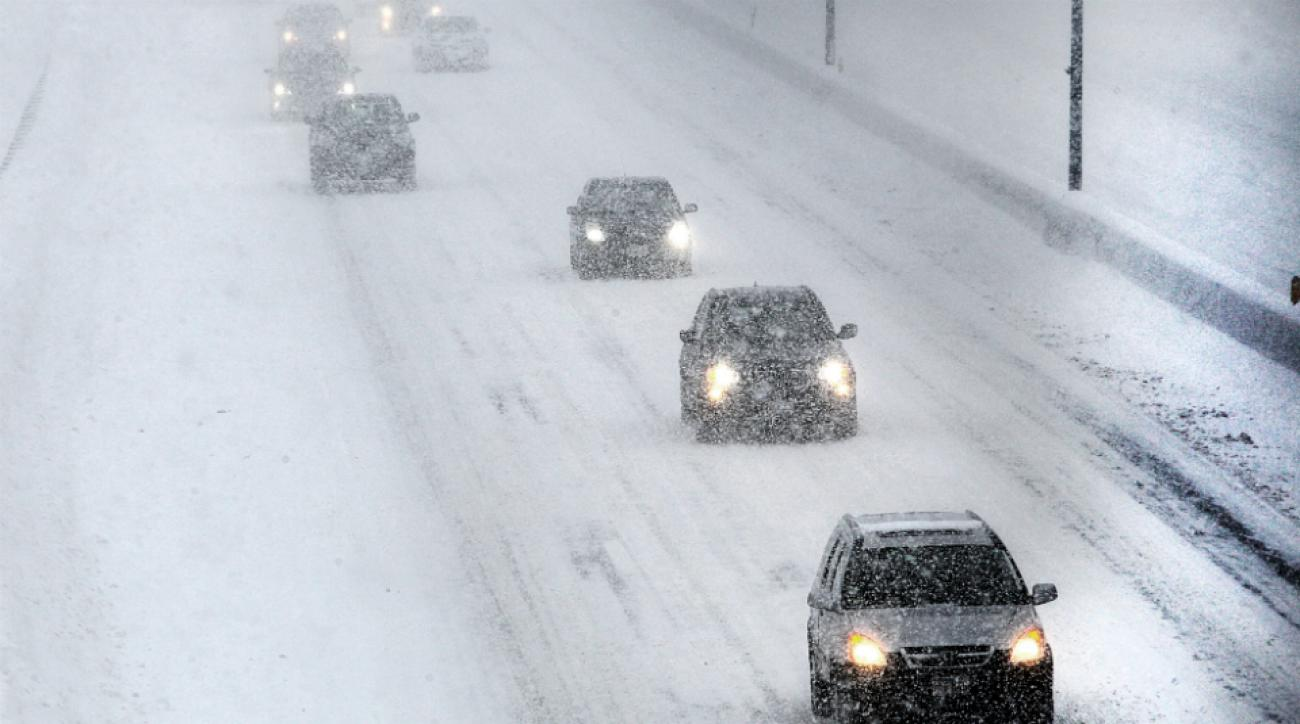 Drivers fight snowy conditions on the Mass Turnpike during Monday's commute home.