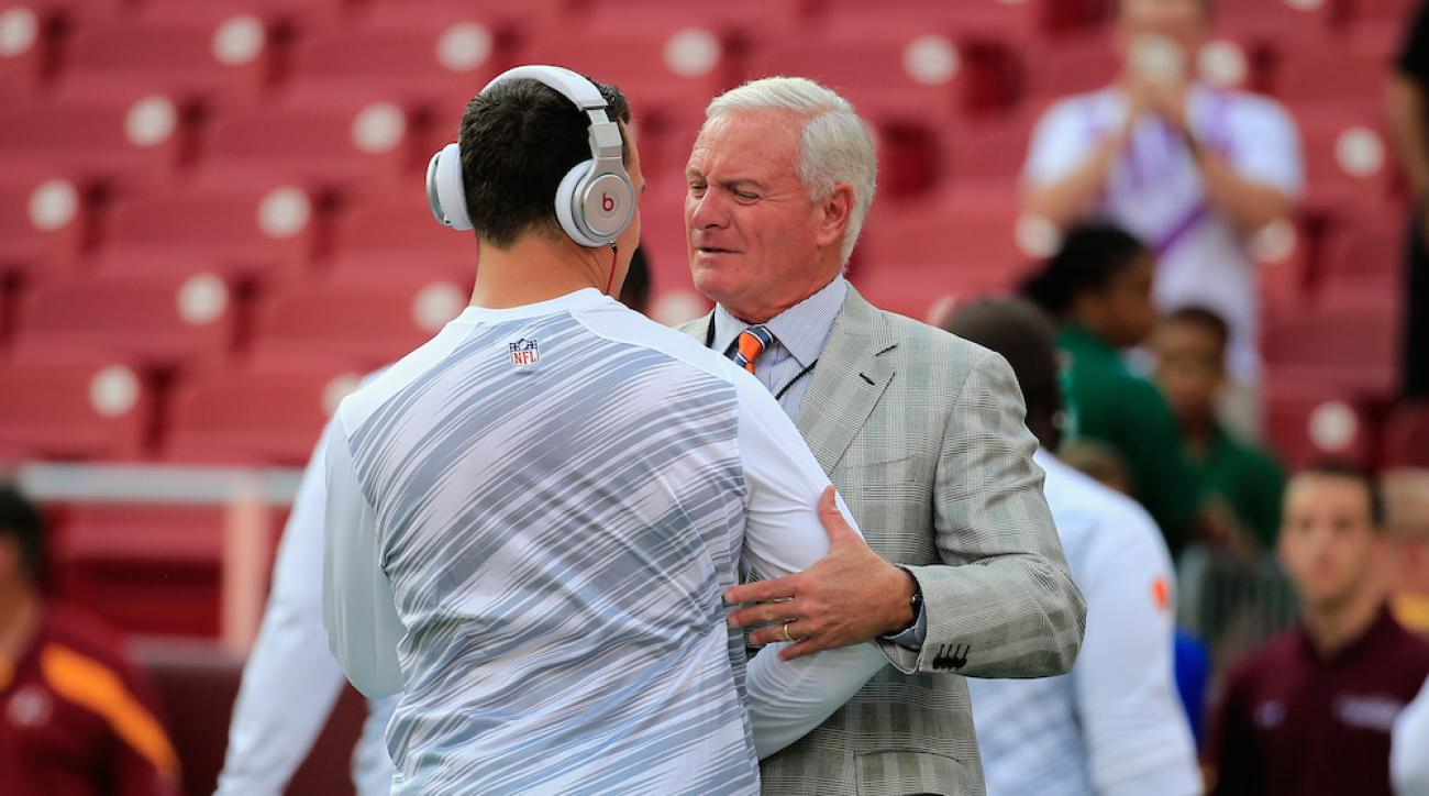 Cleveland Browns owner Jimmy Haslam speaks with quarterback Johnny Manziel before a preseason game against the Washington Redskins on Aug. 18, 2014.