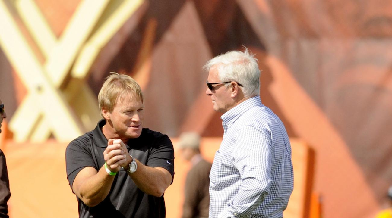 Jon Gruden (left) talks with Cleveland Browns owner Jimmy Haslam during a training camp practice on Aug. 15, 2014, in Berea, Ohio.