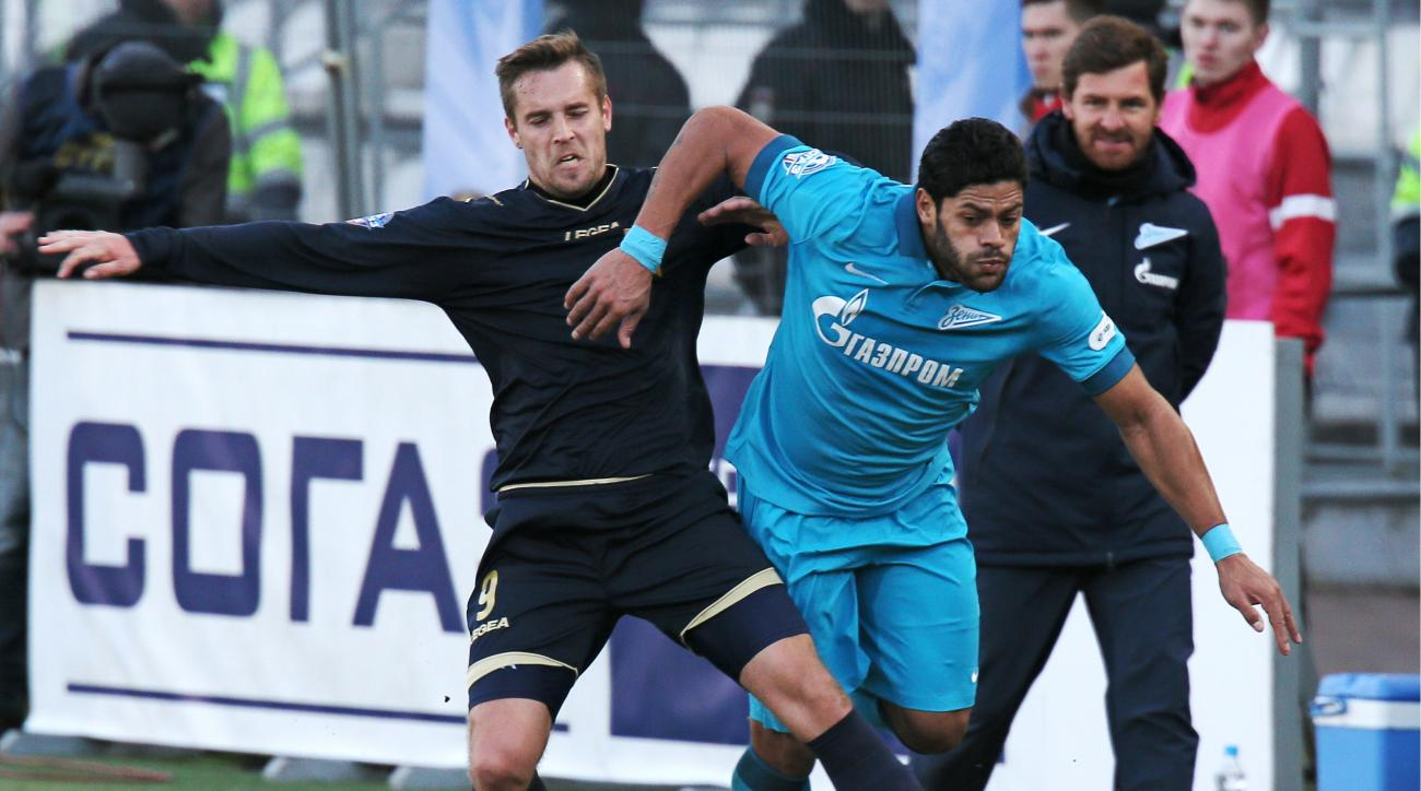 Torpedo Moscow's fans directed a racist chant at Zenit St. Petersburg's Hulk (right)