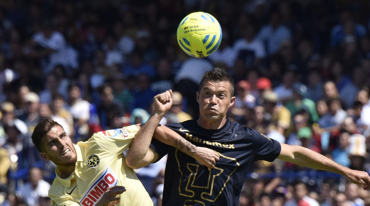 Alvarado (left) playing for Club America