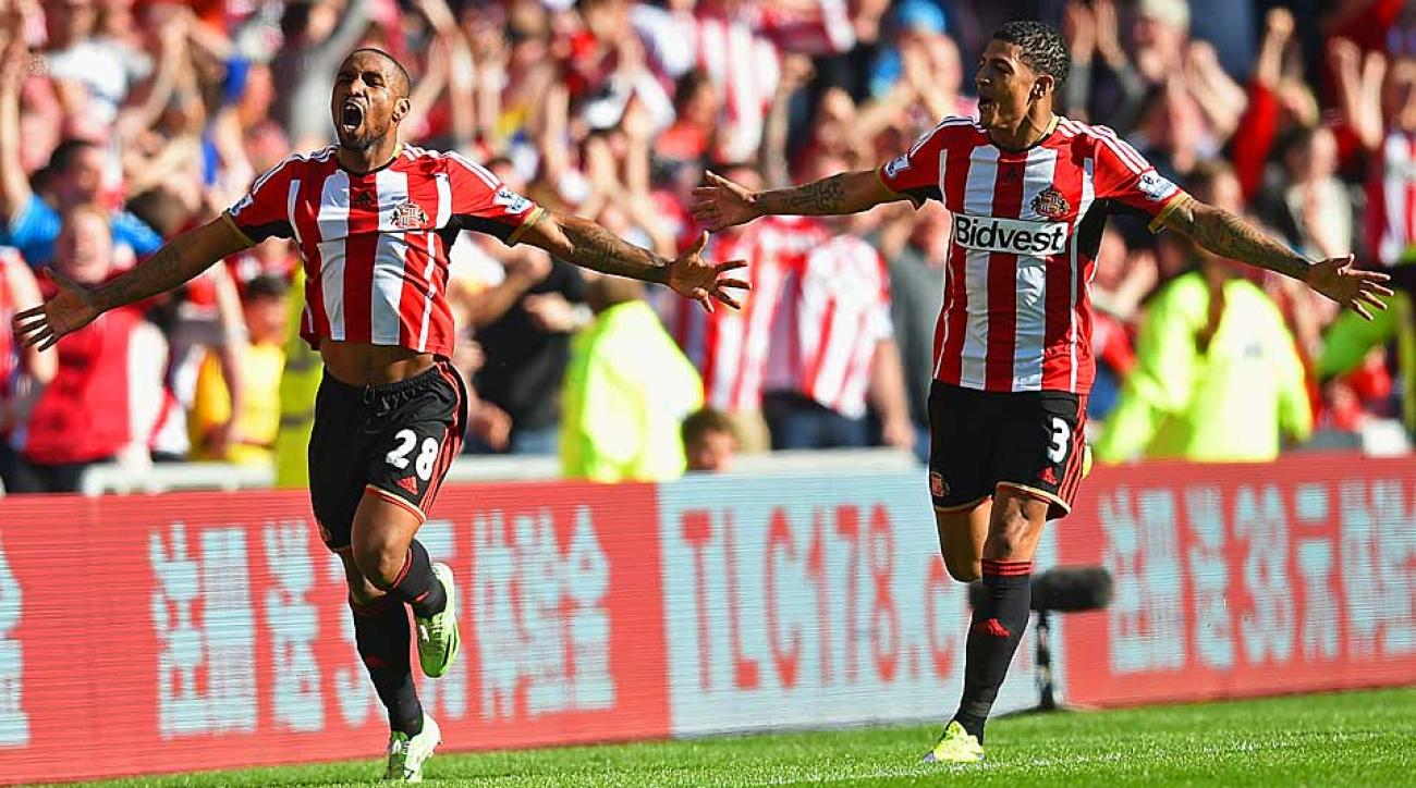 Jermain Defoe (left) celebrates his goal with Patrick van Aanholt