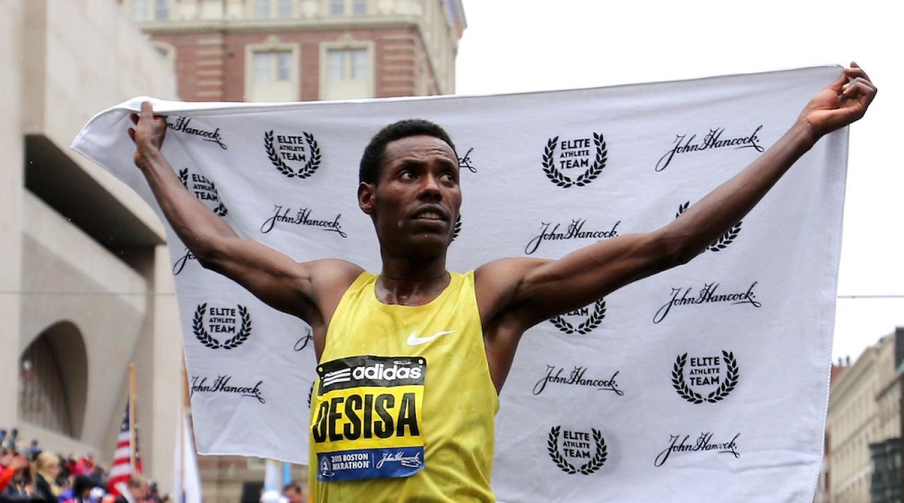 Lelisa Desisa of Ethiopa celebrates after winning the 119th Boston Marathon.