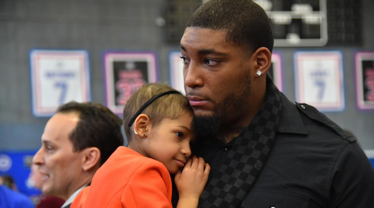 Devon Still with his daughter, Leah, at a NBA FIT All-Star Community Event in New York, N.Y., on Feb. 13, 2015.