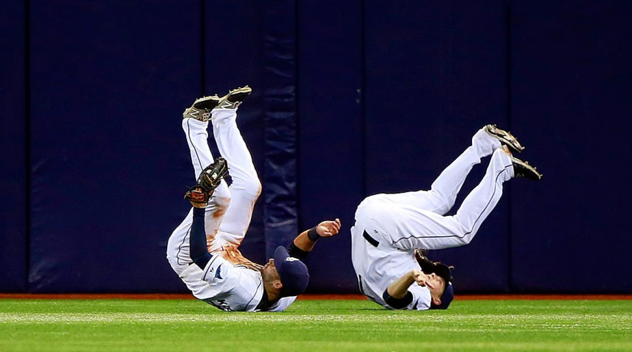 The Rays' Kevin Kiermaier (left) collided with Daniel Nava after making a catch on Wednesday night