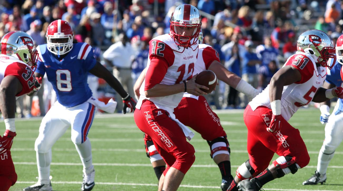 Western Kentucky's Brandon Doughty (12) looks to running back Leon Allen (33) during a game against Louisiana Tech on Nov. 1, 2014.