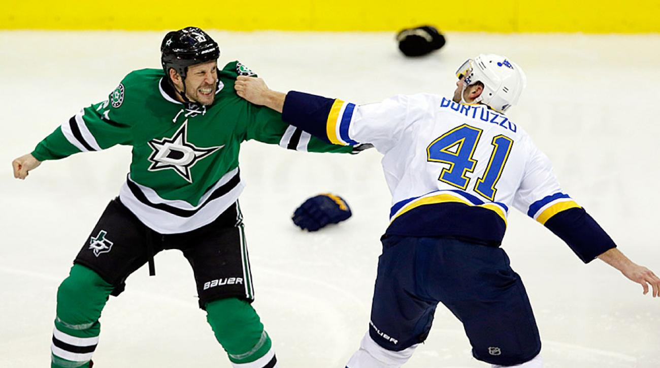 The Blues' Robert Bortuzzo (right) in a fight with the Stars' Travis Moen