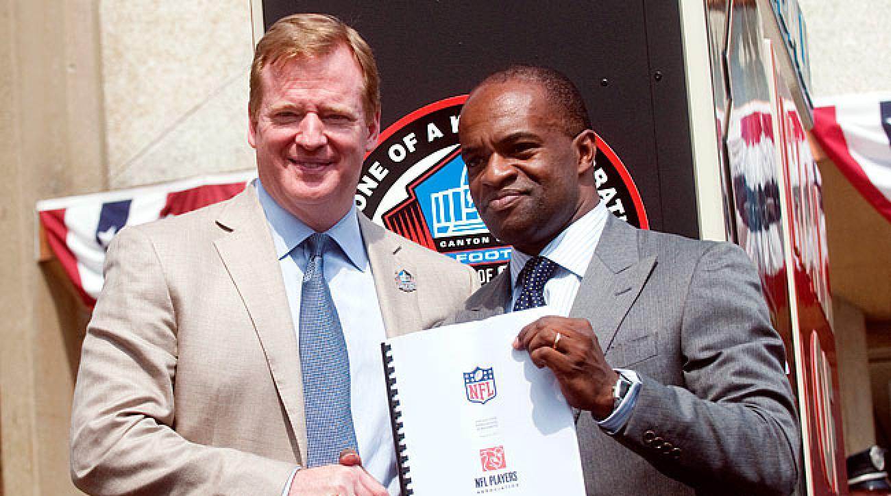 Roger Goodell (l.) DeMaurice Smith shook hands after signing the new CBA on Aug. 5, 2011.