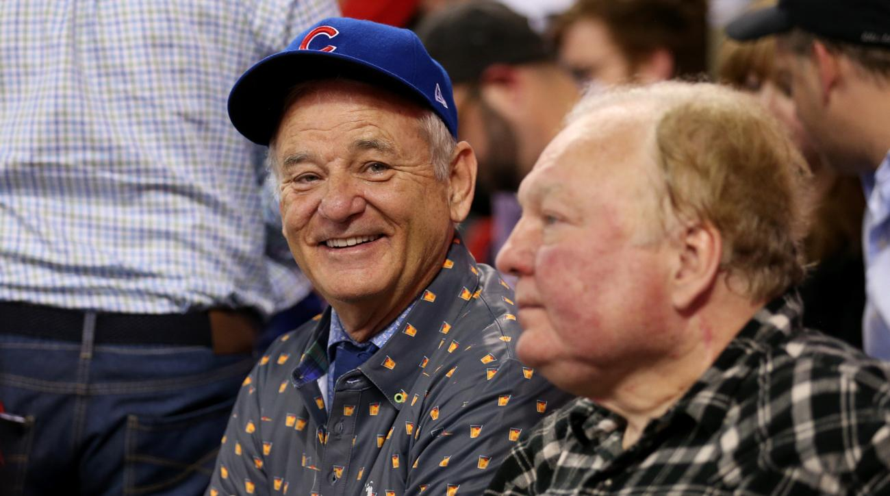 bill murray is buying beers for fans around him