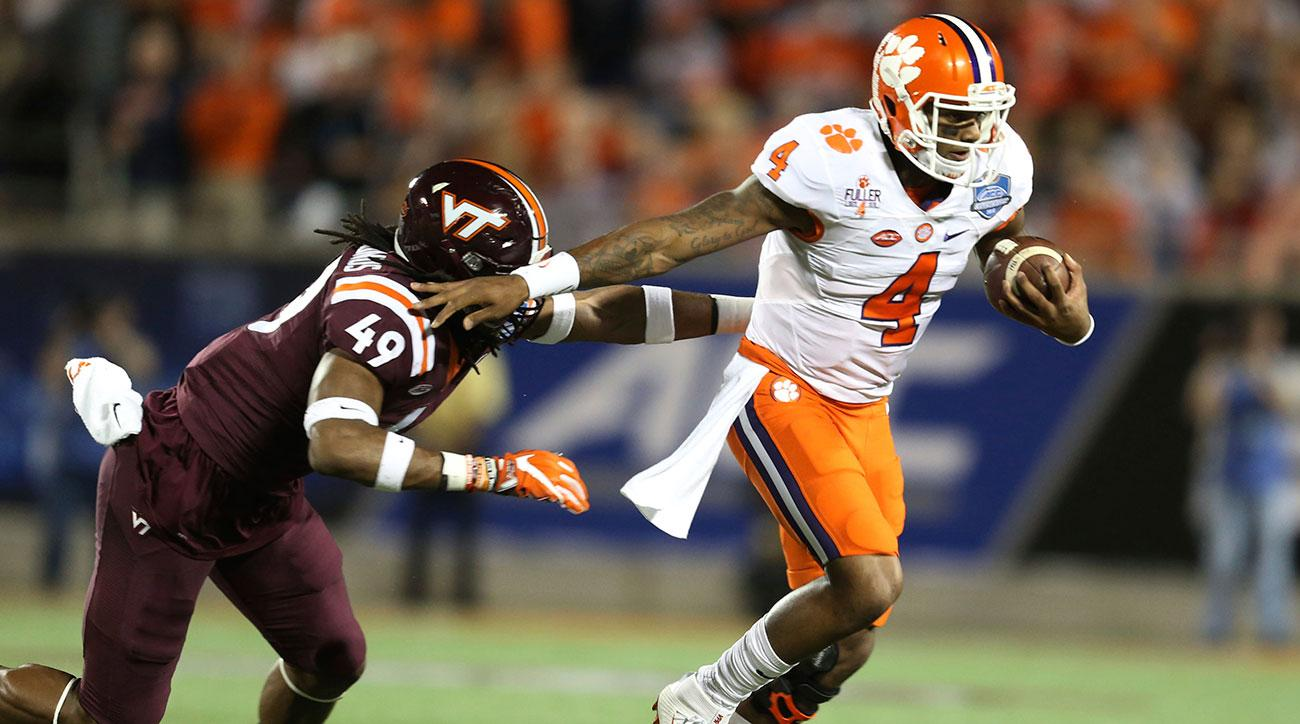 Clemson quarterback Deshaun Watson (4) gets away from Virginia Tech linebacker Tremaine Edmunds (49), during the first half of the Atlantic Coast Conference championship NCAA college football game, Saturday, Dec. 3, 2016, in Orlando, Fla. (AP Photo/Willie